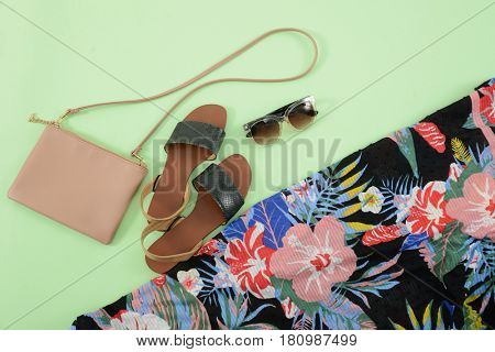 Fashion. Summer woman accessories-Summer floral scarf, shoes, sunglasses, bag,on green background