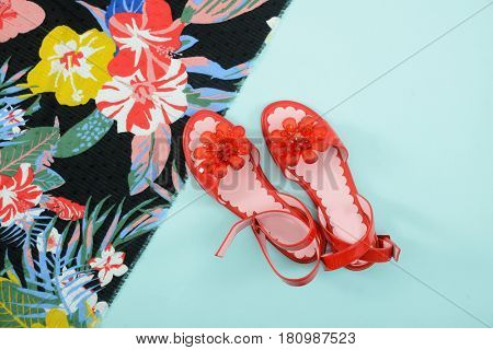 Fashion. Summer woman accessories-Summer floral scarf, shoes on blue background