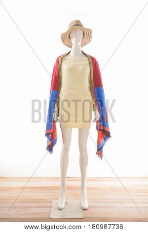 full-length female clothing with hat,scarf on mannequin