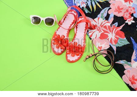 Fashion. Summer woman accessories-Summer floral scarf, shoes,hat, sunglasses,on green background
