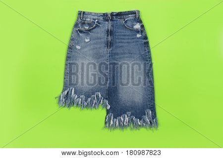Blue denim skirt isolated on blue and green background