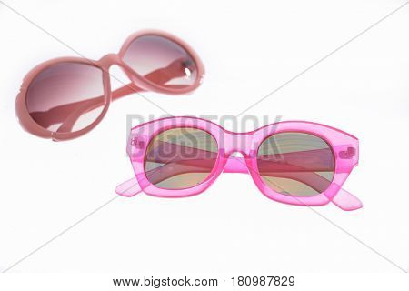 two sunglasses on white background