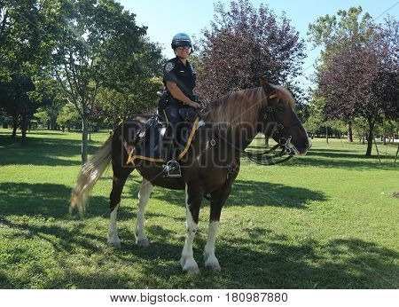 NEW YORK - AUGUST 27, 2016: NYPD mounted unit police officer ready to protect public at Billie Jean King National Tennis Center during US Open 2016 in New York