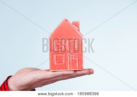 Male Hand With Little Red House.