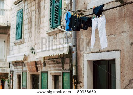 Clothes dries on ropes on clothespins. Drying clothes.