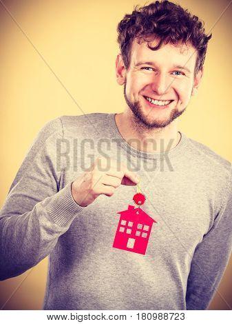 Man Holding Key With House Symbol
