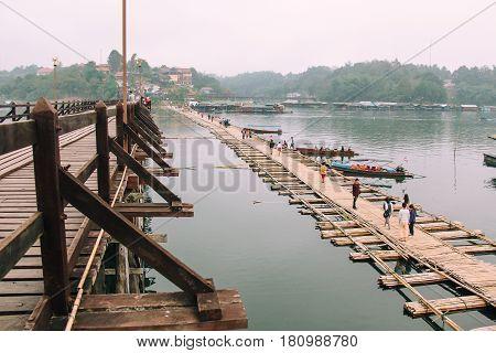 Kanchanaburi Thailand - December 09 2013: Temporary Bridge beside Saphan Mon (Mon Bridge) due to heavy flood damaged the old wooden bridge across Song Karia River in morning time in Sangklaburi District