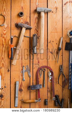 Carpentry tools hanging on the wooden wall