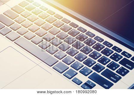 Close-up of laptop keyboard thai keyboard notebook keypad.