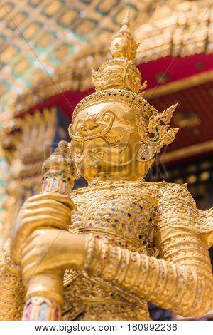 Closeup beautiful Golden Giant in Wat Phra Kaew or the Temple of the Emerald Buddha or Wat Phra Sri Rattana Satsadaram Bangkok Thailand.