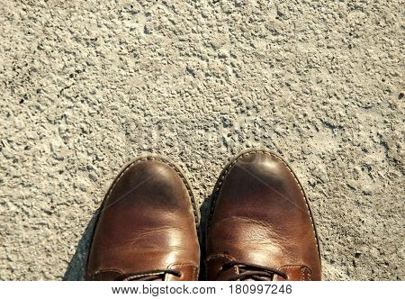 Brown leather boots stand on the ground, Brown boots