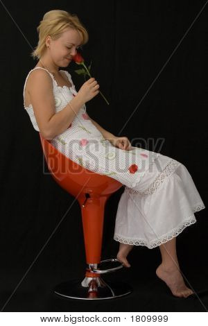 Woman With A Rose Smiling
