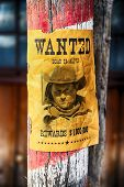 vintage wanted poster in a gost town in west usa poster