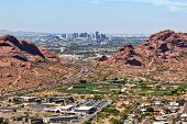 Downtown Phoenix Arizona aerial view from Scottsdale framed between the Papago Buttes poster
