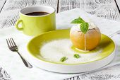 baked apple with icecream on green dish poster