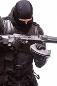 SWAT officer with assault rifle in black uniform isolated on white background poster