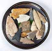 Plate full of real American indian arrowheads found in Texas and Missouri made around 7000 to 8000 years ago. poster