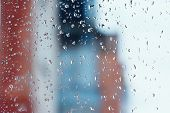 Textures of water droplets of rain flow down the windowpane. Condensation high humidity large drops of water cold tone natural water droplets on clear glass. Natural water drop background poster