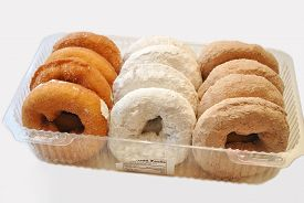 Twelve Fresh Packaged Plain and Powdered Donuts