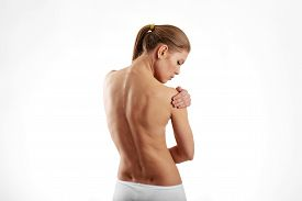 Woman having shoulder pain and injury over white.