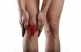 Woman suffering from knee pain. Anatomy and medicine concept.