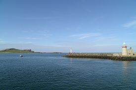 Harbour with beautiful lighthouse tower at Howth (Dublin bay Ireland).