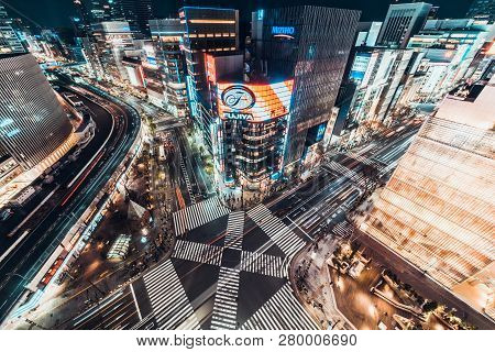 Tokyo, Japan - Jan 13, 2019: Cityscape Aerial Night View Of Ginza Zebra Crosswalk Road Intersection