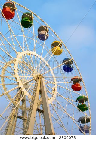 Big Ferris Wheel On Cloudy Sky