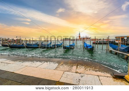 Venice, Italy - September 18 2018: The Sun Sets Behind The Church Of San Giorgio Maggiore And Bell T