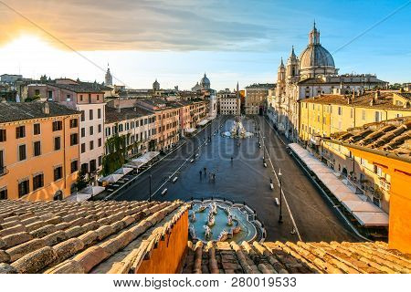 Rome, Italy - September 30 2018: Sunrise Over The Piazza Navona As The Sunlight Lights The Dome On T