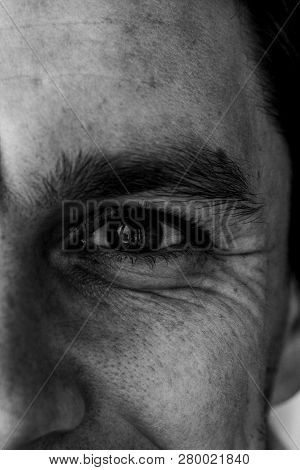 Fragment Of A Man's Face: Left Eye And Nose To Compile An Identikit. Fragment Of The Wrinkled Face O