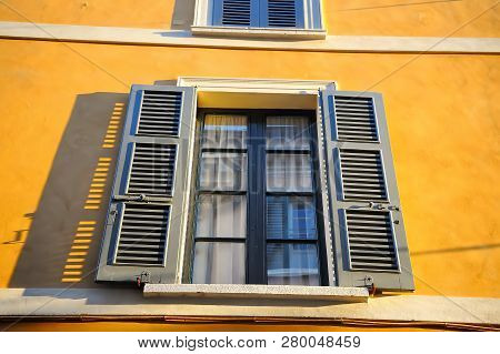 Window With Blinds An Ancient Building In Trastevere. Rome, Italy. Architectural Details.