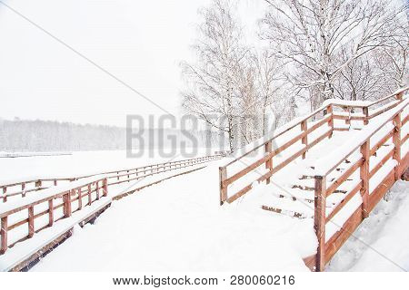 Stairs Under Snow In A City Park In Winter