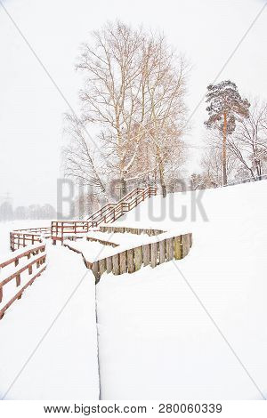 Wooden Fence In A Park In Winter