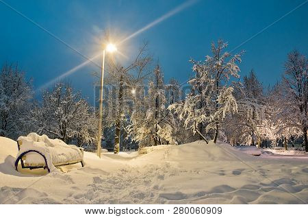 Street Lamp And Bench In The Evening Winter Park