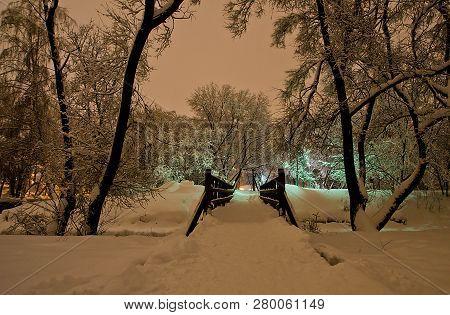 Bridge In The Winter Park In The Evening