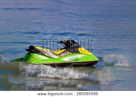 Tourists Enjoy Driving Jetski On The Ocean, Space For Text. Hot Summer Time