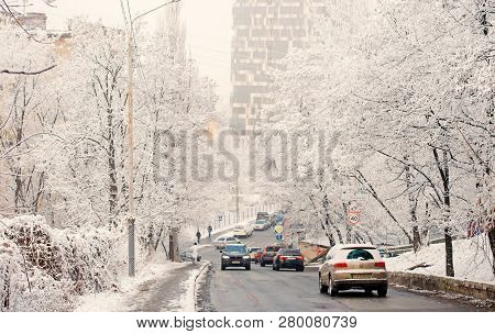 Kyiv, Ukraine-23 November, 2016 : City Road Traffic In Winter, Transport. Cars Drive On Snow Covered
