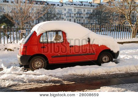 ST.LEONARDS-ON-SEA, ENGLAND - DECEMBER 3: Snow covers a car parked in Warrior Square on December 3, 2010 at St.Leonards-on-Sea, East Sussex. It is the coldest Winter for 100 years in Britain.