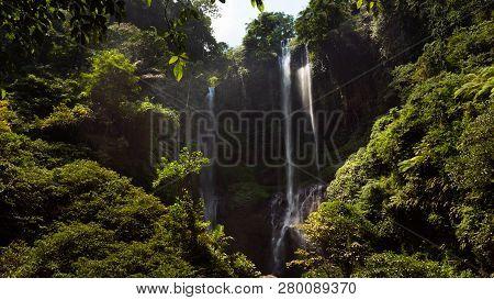 Waterfall In Green Rainforest. Triple Tropical Waterfall Sekumpul In Mountain Jungle. Bali, Indonesi