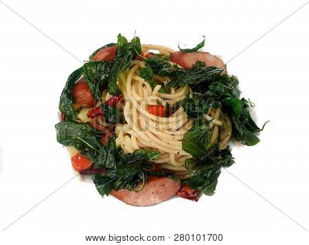 Thai food style (Spaghetti Pad Kee Mao), Spaghetti with sausage, mushroom and Crispy basil isolated on white background, top view, This food is most popular Thai food poster