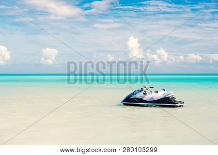 Jet ski on turquoise sea water in Antigua. Water transport, sport, activity. Speed, extreme, adrenaline. Summer vacation on caribbean. Wanderlust, travel, trip Adventure discovery journey poster