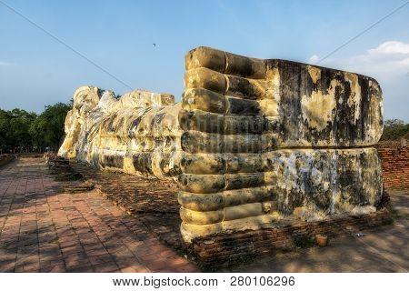 Phra Noon Reclining Buddha At Wat Lokayasutharam In Ayutthaya, Thailand