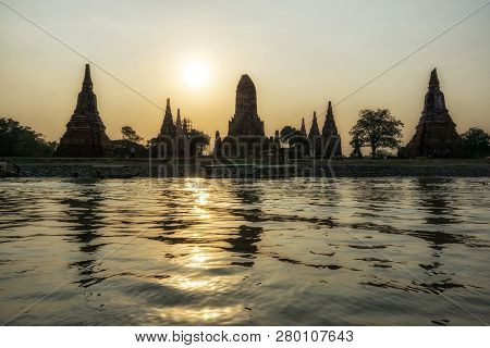 The View Of Wat Chaiwatthanaram Taken During Sunset Hours With The Reflection On The Chao Phraya Riv