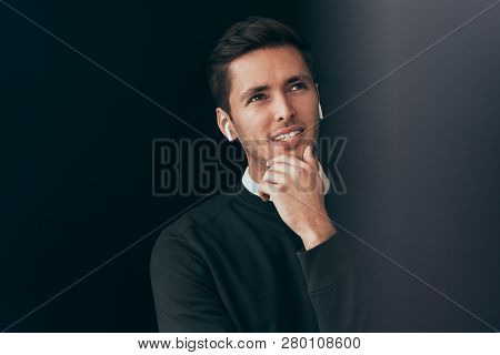 Horizontal Portrait Of Young Handsome Man Have A Call With A Colleague Isolated On Black Background,