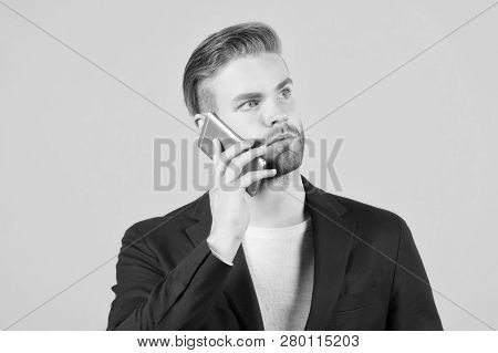 Wait Connection. Man Well Groomed Speak Mobile Phone Grey Background. Businessman Serious Call Mobil