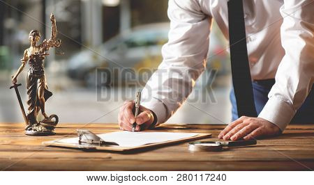 Signing Official Document In Office And Justice Concept