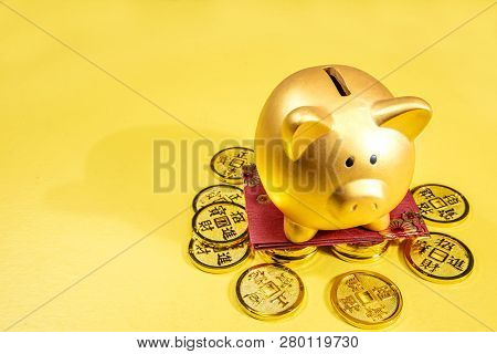 Piggy Bank With Golden Coins And Red Envelopes Over Yellow Background. Chinese New Year. Year Of The