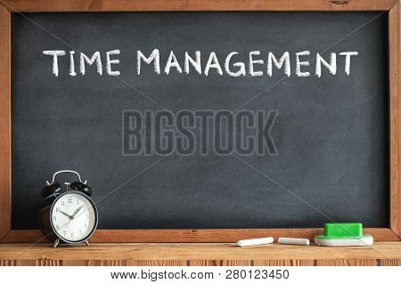Time Management Concept With Clock And Blackboard