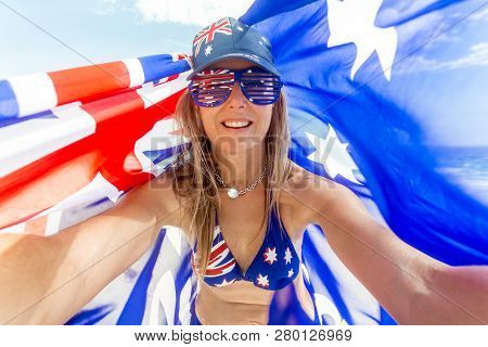 Celebrate Australia, Australia Day, Female Aussie Fan Or Sports Supporter.  Woman Holding Up An Aust